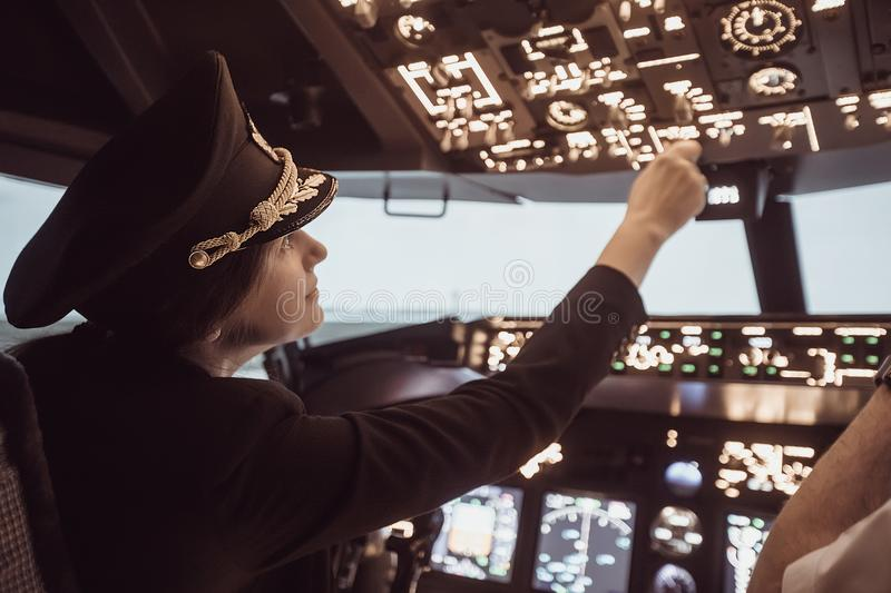 Female pilot captain prepares for take-off plane stock images