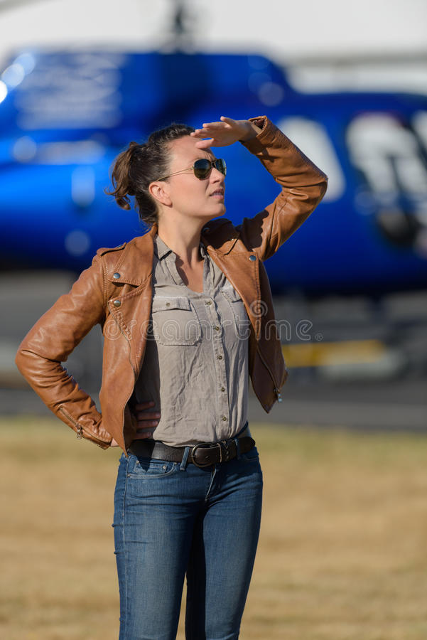 Female pilot looking into distance royalty free stock photo