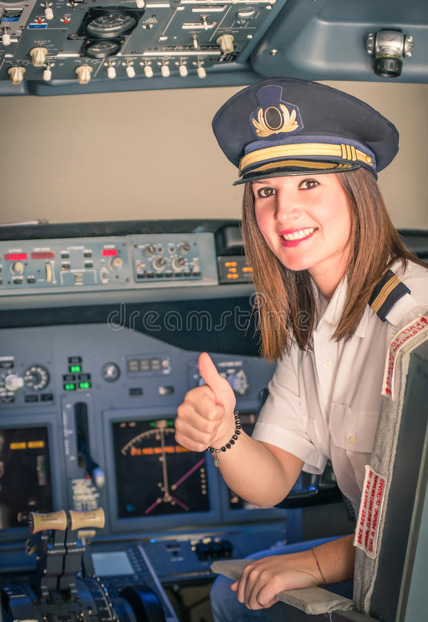 Female Pilot ready for Take Off. Portrait of a Female Pilot ready for Take Off stock photography