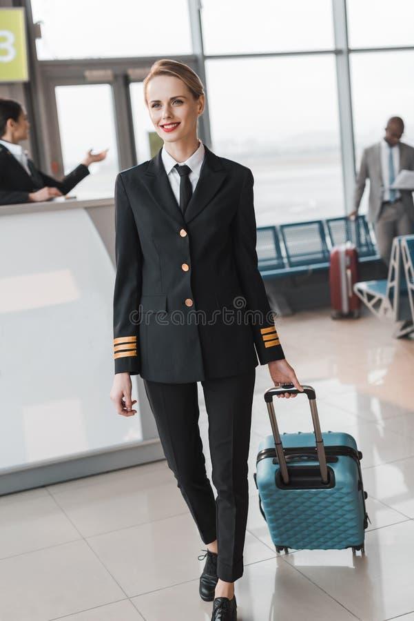 female pilot with suitcase walking stock photos