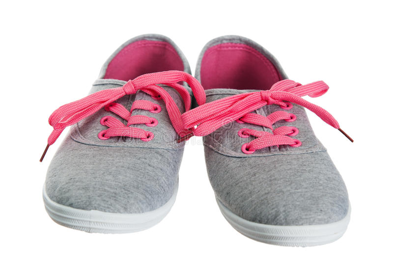 Female pink sneakers stock photos