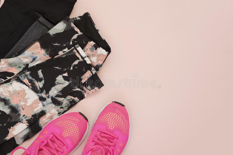 Female pink sneakers, sport shoes, leggings in flat lay style, top view. Fitness concept, active lifestyle, body care concept. Cop royalty free stock image