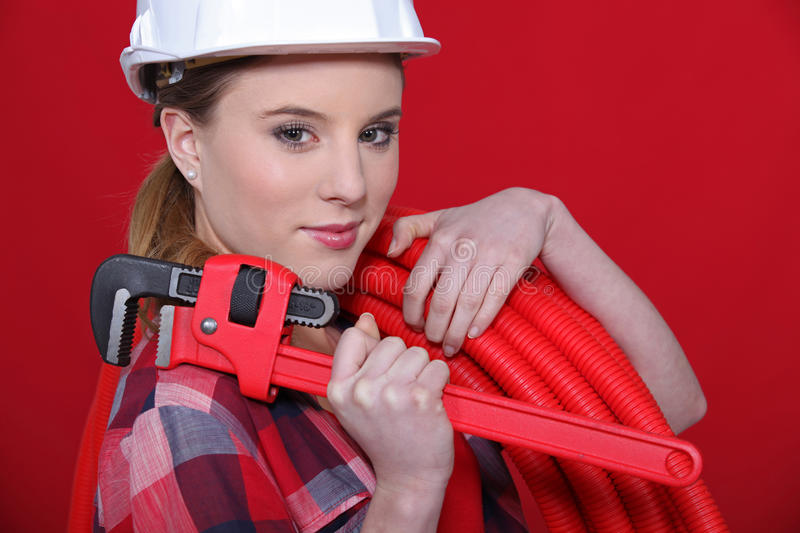 Female plumber. Equipped to fix problem royalty free stock photography