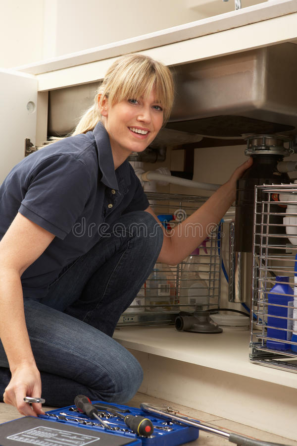 Download Female Plumber Working On Sink Stock Photo - Image: 18745162