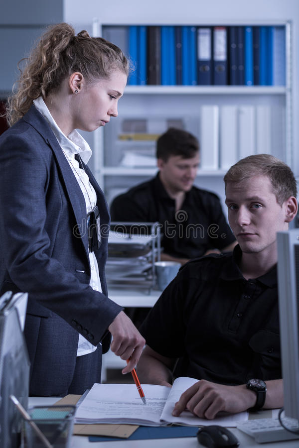 Female police commander. And young policeman at work stock images