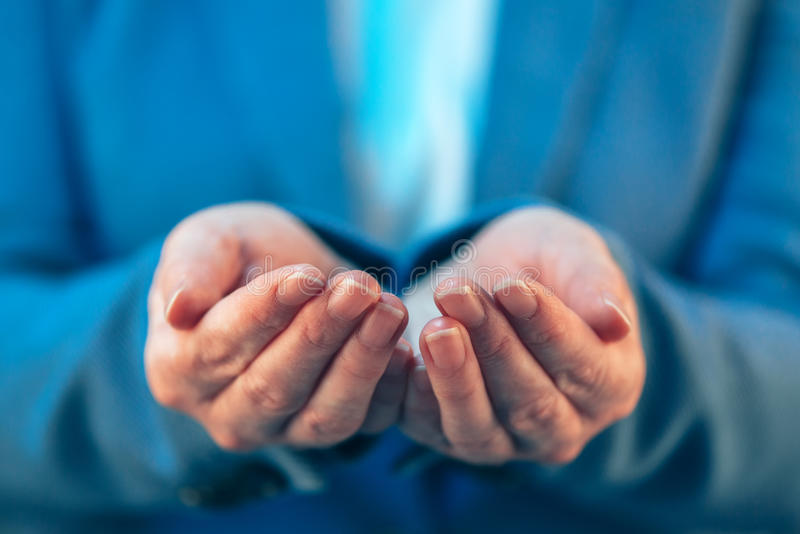 Female politician with open palms of her hands stock photo