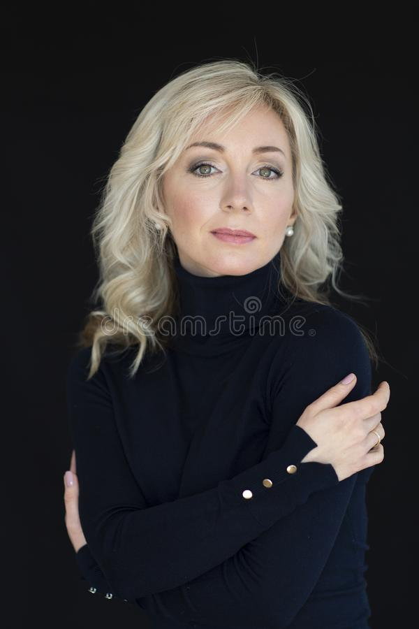 Female portrait on a black background. Woman the blonde, emotions. Black and White photon stock photography