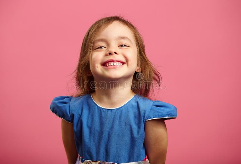 Female portrait of charming child of three years with a beautiful smile. royalty free stock photos