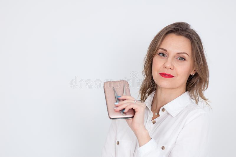 Female Portrait of Cute Cosmetician with Blond Hair and Sensual Red Lips Holding Instruments for Manicures in Studio on stock images