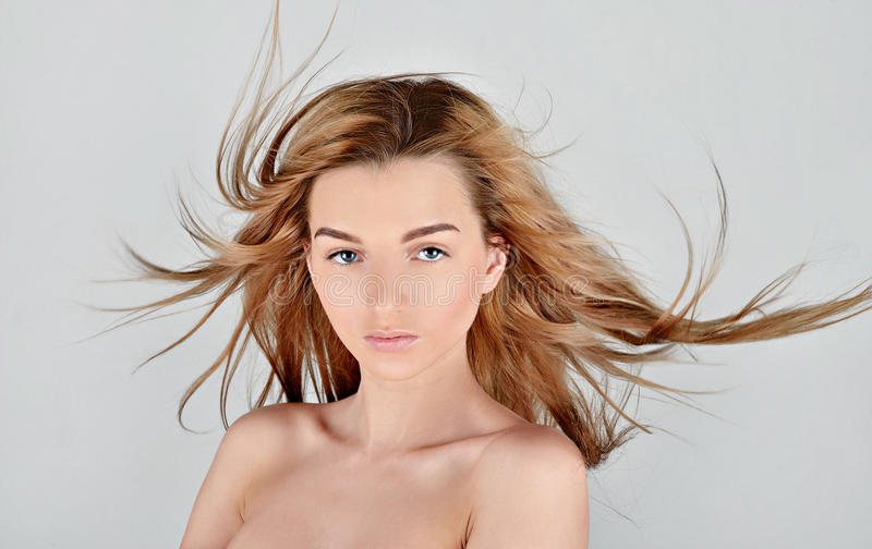 Female portrait of cute lady isolated on a white background. Close up beautiful model girl in elegant pose. Closeup beauty blonde woman with hairstyle indoors stock photos