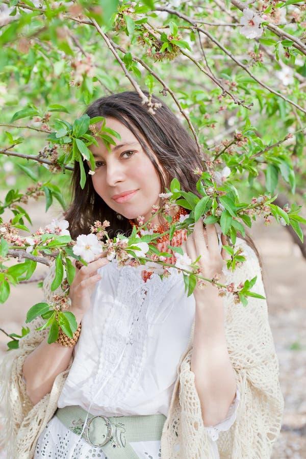 Female portrait in spring blossom. Beautiful female portrait in spring tree blossom stock image