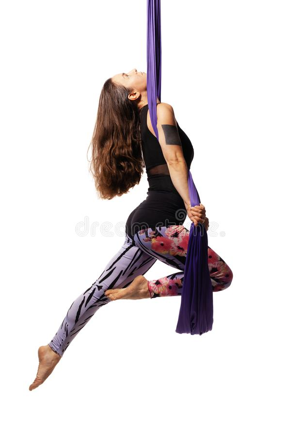 Girl practicing aerial yoga stock images