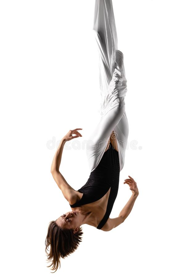 Girl practicing aerial yoga royalty free stock photo