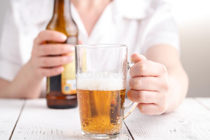 Female pouring beer in glass mug, relax concept royalty free stock images