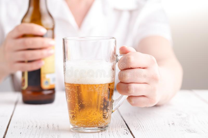 Female pouring beer in glass mug, relax concept stock photos