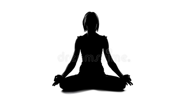 Female practicing meditation lotus pose, spiritual unity of body and soul, peace stock images