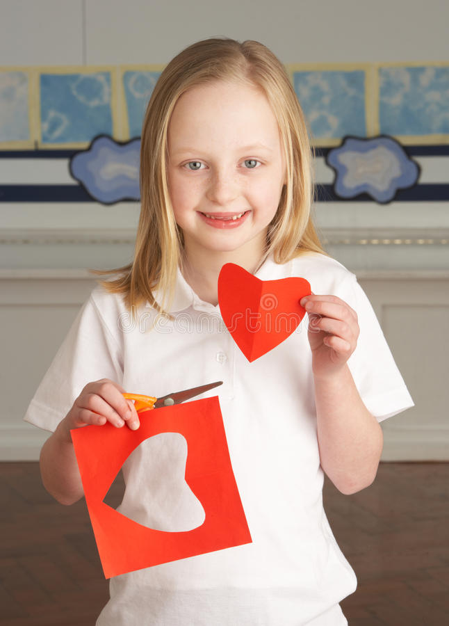 Female Primary School Pupil Cutting Out Shapes Stock Photography