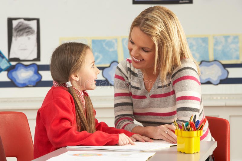 Female Primary School Pupil And Teacher Working Royalty Free Stock Image