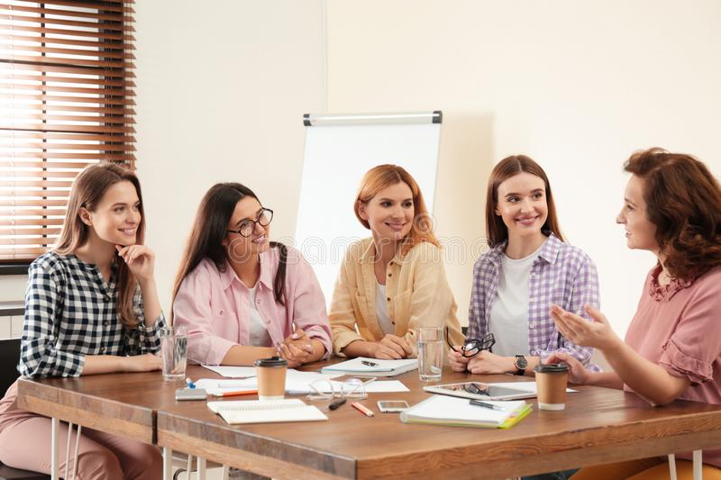 Female professional business team working in office stock photography
