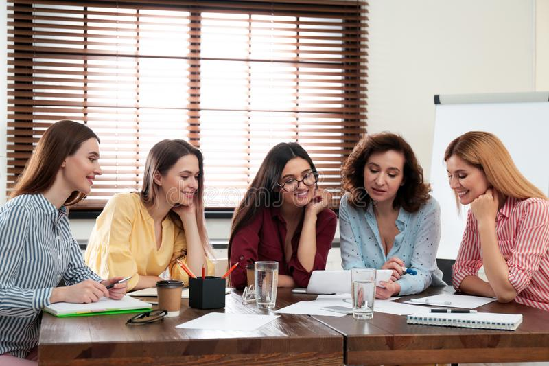 Female professional business team working in office stock photo