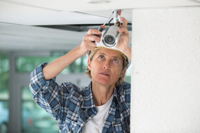 Female professional cctv technician working stock photo