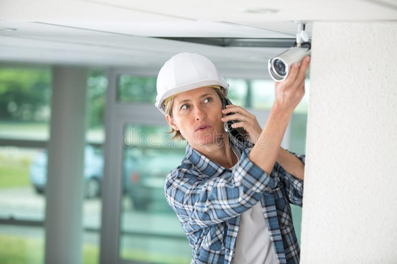Female professional cctv technician working stock photography