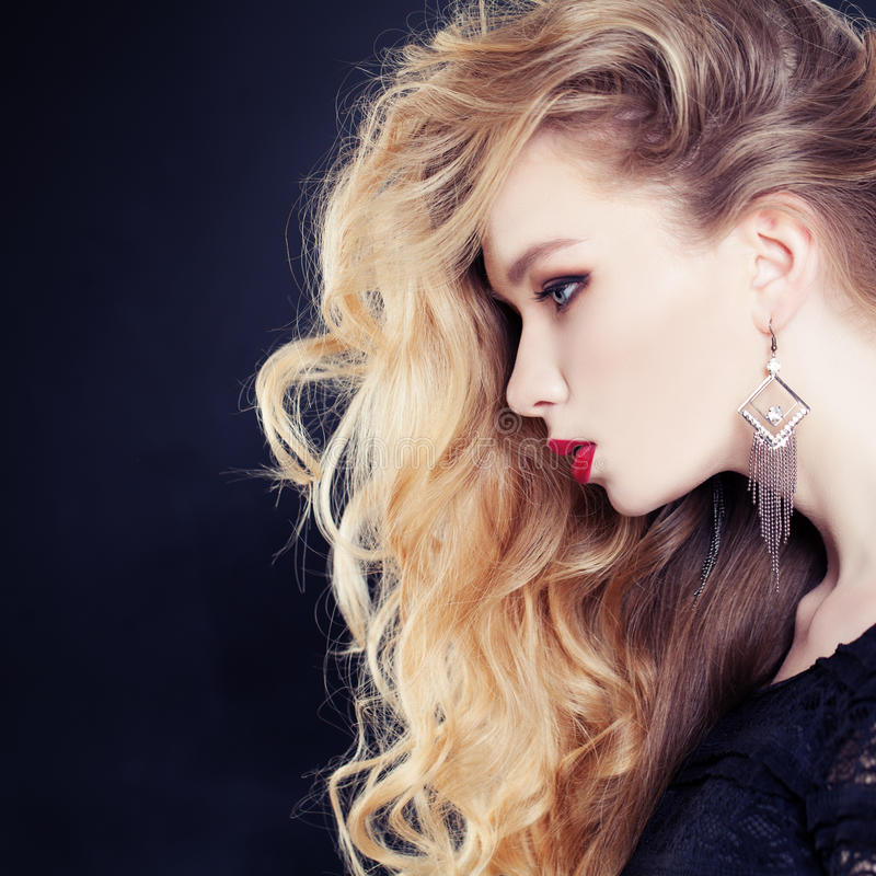 Female Profile. Beautiful Woman with Long Wavy Blonde Hair stock photography
