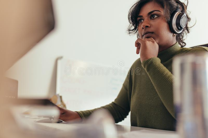 Female programmer working on computer stock image