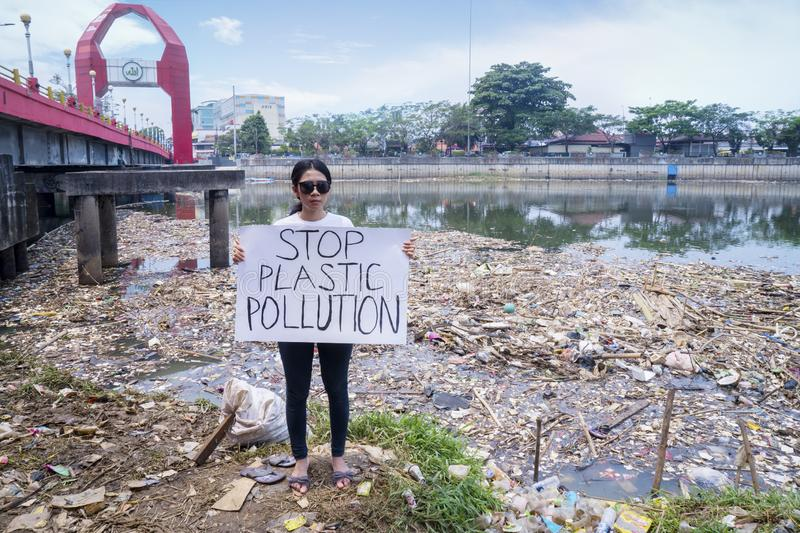 Female protesters with text of Stop Plastic Pollution. JAKARTA - Indonesia. September 18, 2019: Female protesters holding a poster with text of Stop Plastic stock images