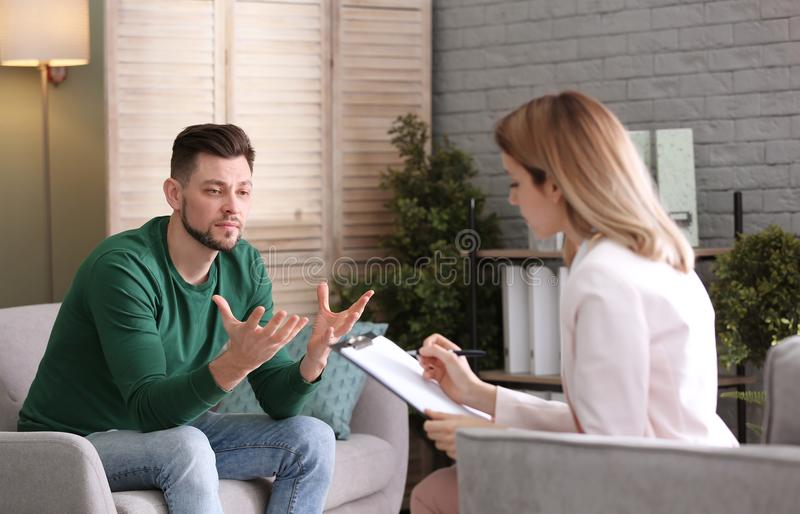 Female psychologist with client. In office royalty free stock photos