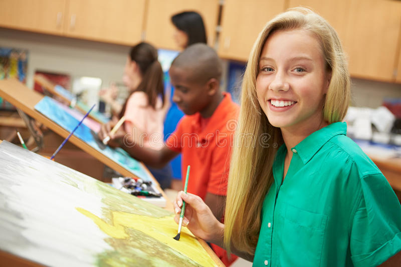 Female Pupil In High School Art Class. Smiling At Camera stock image
