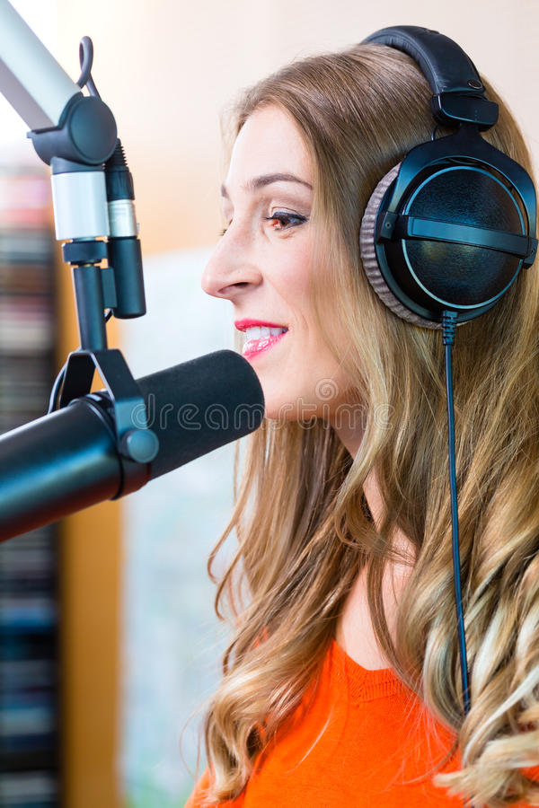 Female radio presenter in radio station on air royalty free stock photography