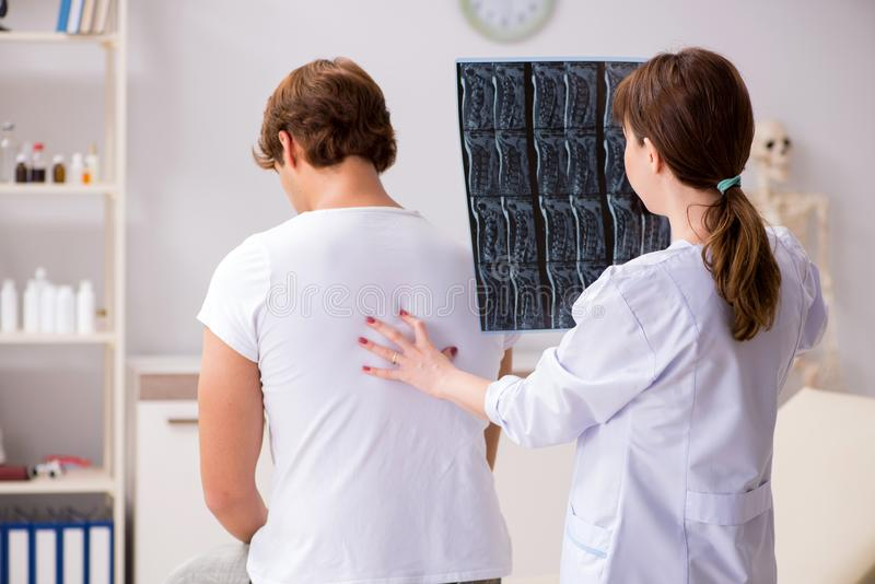 The female radiologist detecting cause of the illness. Female radiologist detecting cause of the illness stock photography