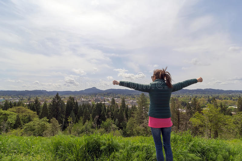 Female raised arms at top of Skinner Butte Park royalty free stock images