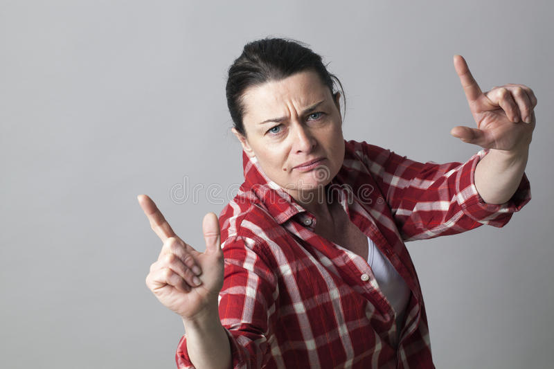 Female rapper showing an aggressive hand gesture for arrogant attitude. Independent middle aged female rapper showing an aggressive hand gesture with fingers up stock images