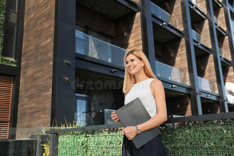 Female real estate agent. With clipboard outdoors royalty free stock photography