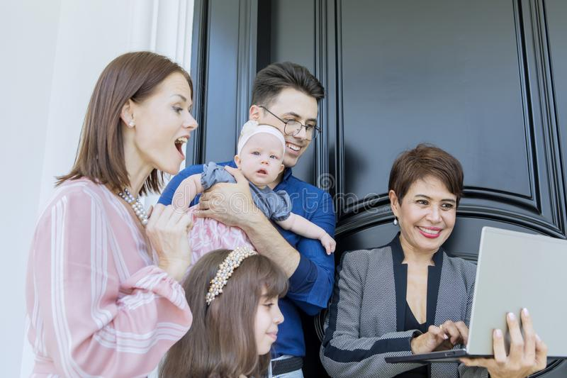 Real estate agent explains new property to her client. Female real estate agent holding a laptop while explaining new property to her client stock photos