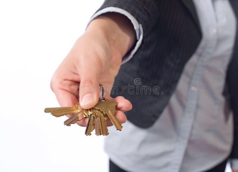 Female real estate agent keys