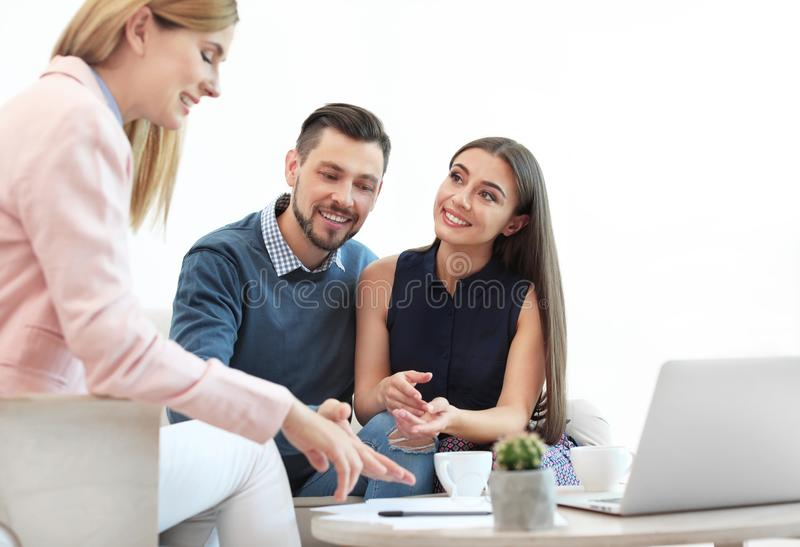 Female real estate agent working with couple. In office royalty free stock photo
