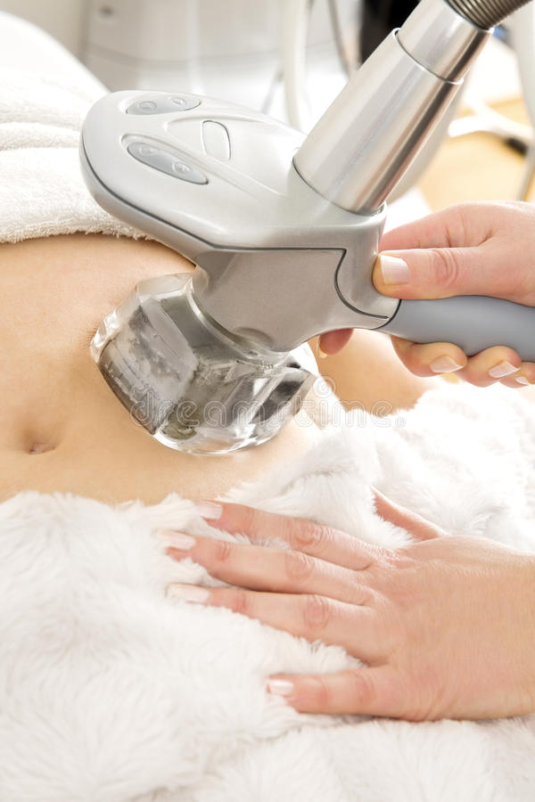 Female receive vacuum treatment at body clinic stock images