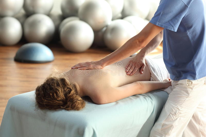 Female Receiving Back Massage Royalty Free Stock Photography
