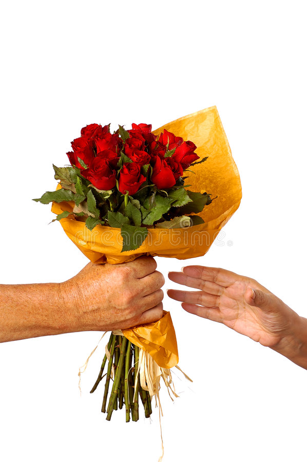 A female receiving flowers from a male stock images