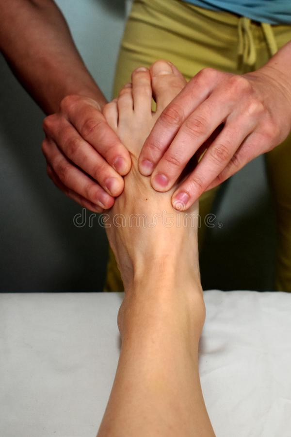 Massage of the left sole royalty free stock images