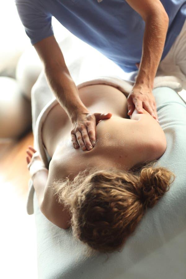 Female receiving shiatsu massage stock image
