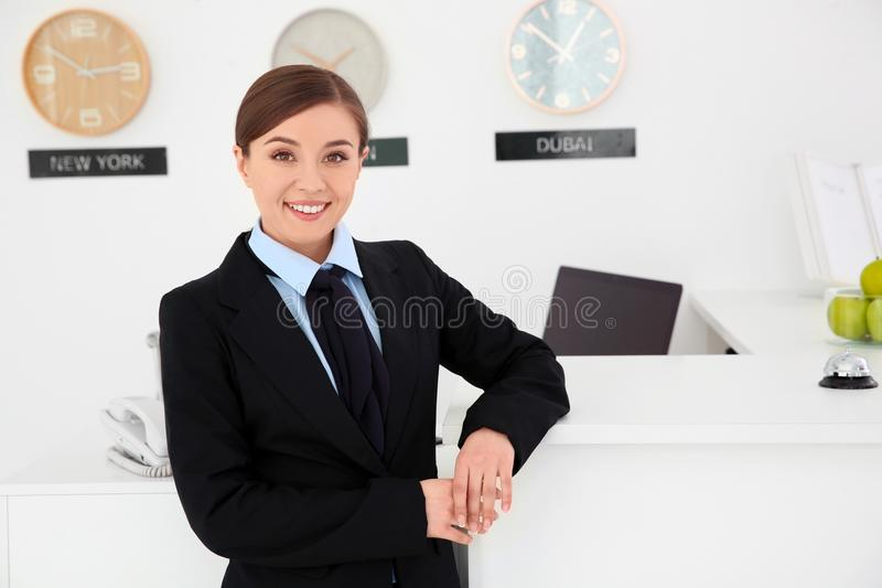 Female receptionist at workplace stock image