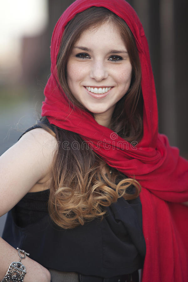 Female with red scarf. Young adult female with red scarf wrapped around her head stock images