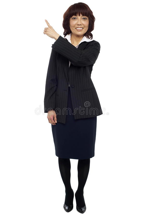 Download Female Representative Pointing At Copy Space Area Stock Image - Image: 26509855