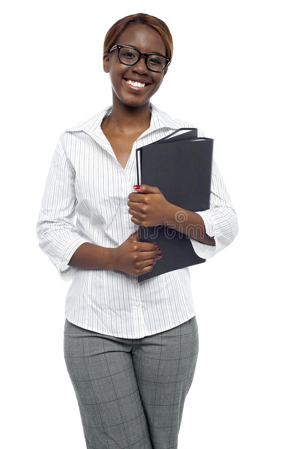 Download Female Representative Posing With File Folder Stock Photo - Image: 26509982