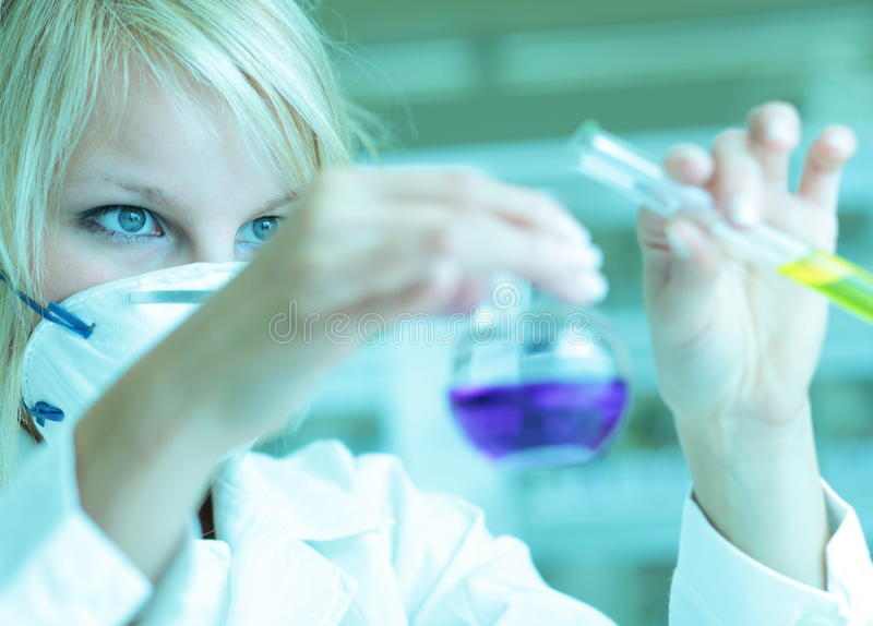 Female researcher in a lab. Closeup of a female researcher carrying out experiments in a lab royalty free stock photos