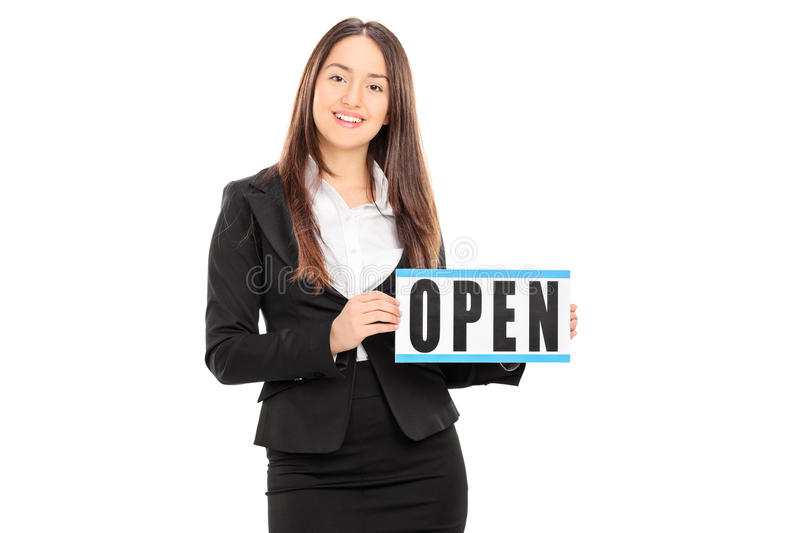 Female retailer holding an open sign. Isolated on white background royalty free stock photo